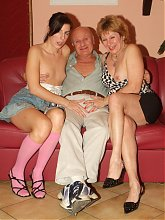 Naughty mature wife Martha surprises her hubby and lets sexy Elvira join them in a live threesome