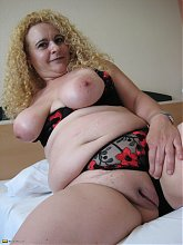 This big blonde mature slut loves to play with herself