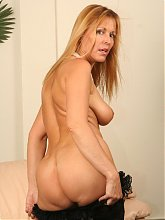 Photos of a horny blonde MILF named Nicole Moore mouthing a black pole and getting impaled
