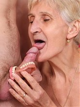 Slutty granny Irene hooks up with a young stud and got her cooter fucked hard after slurping his cock live